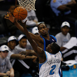 Mar 22, 2010; New Orleans, LA, USA; New Orleans Hornets guard Darren Collison (2) shoots over Dallas Mavericks guard Rodrigue Beaubois (3) during the first half at the New Orleans Arena. Mandatory Credit: Derick E. Hingle-US PRESSWIRE