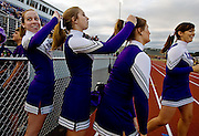 Senior members of the cheer squad help each other get ready before the game.