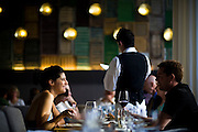 Gina Carrasco, left, and Dave Langbehn, right, enjoy dinner at the Ella Dining Room and Bar in Sacramento, California.