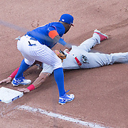 NEW YORK, NEW YORK - July 26: Tommy Pham #28 of the St. Louis Cardinals is tagged out at third base by Jose Reyes #7 of the New York Mets during the St. Louis Cardinals Vs New York Mets regular season MLB game at Citi Field on July 26, 2016 in New York City. (Photo by Tim Clayton/Corbis via Getty Images)