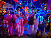26 AUGUST 2018 - GEORGE TOWN, PENANG, MALAYSIA: Chinese opera performers participate in a prayer before a Hokkien style Chinese opera on the Lim Jetty in George Town for the Hungry Ghost Festival. The opera troupe came to George Town from Fujian province in China. The Hungry Ghost Festival is a traditional Buddhist and Taoist festival held in Chinese communities throughout Asia. The Ghost Festival, also called Ghost Day, is on the 15th night of the seventh month (25 August in 2018). During the Hungry Ghost Festival, the deceased are believed to visit the living. In many Chinese communities, there are Chinese operas and puppet shows and elaborate banquets are staged to appease the ghosts.     PHOTO BY JACK KURTZ