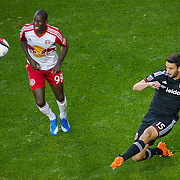 Nov 8, 2015; Harrison, NJ, USA; D.C. United defender Steve Birnbaum (15) kicks the ball in front of New York Red Bulls forward Bradley Wright-Phillips (99) during the second half of the MLS Playoffs at Red Bull Arena. Mandatory Credit: William Hauser-USA TODAY Sports