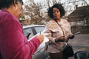 BIRMINGHAM, AL – DECEMBER 4, 2017: Birmingham City Councilor Sheila Tyson returns to her vehicle after assisting residents with their voting eligibility at Four Winds West, a section 8 assisted living complex in west Birmingham.  CREDIT: Bob Miller for The New York Times