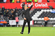 Swansea City manager Graham Potter waves to the fans at full time after his team won 2-0 during the EFL Sky Bet Championship match between Swansea City and Reading at the Liberty Stadium, Swansea, Wales on 27 October 2018.