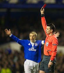 LIVERPOOL, ENGLAND - Tuesday, February 16, 2010: Referee Darko  Ceferin shows the red card to Everton's Sylvain Distin (not showing) against Sporting Clube de Portugal during the UEFA Europa League Round of 32 1st Leg match at Goodison Park. (Photo by: David Rawcliffe/Propaganda)