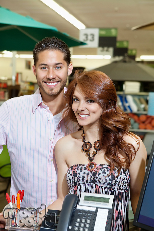 Portrait of a happy couple standing in store