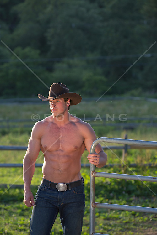 shirtless cowboy working on a ranch