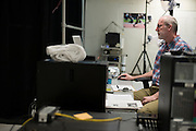 Dr. Laurence Ryan monitors the computer while Ryan Hall runs at the SMU Locomotor Performance Lab in Dallas, Texas on March 18, 2016. (Cooper Neill for The New York Times)