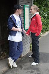 Teenage Couple holding hands,