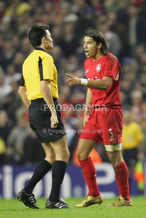 LIVERPOOL, ENGLAND- WEDNESDAY DECEMBER 8th 2004: Liverpool's Milan Baros argues with referee Manuel Enrique Mejuto Gonzalez during the UEFA Champions League Group A match against Olympiakos at Anfield. (Pic by David Rawcliffe/Proparganda)