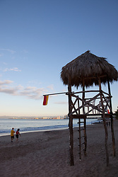 """Life Guard Tower 2"" - These people and palapa style life guard tower were photographed in Puerto Vallarta, Mexico."