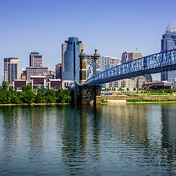 Photo of downtown Cincinnati skyline, John A. Roebling bridge, and downtown city office buildings including Great American Insurance Group Tower, Omnicare building, Scripps Center building, PNC Tower Building, Carew Tower, US Bank Building, and Fifth Third Bank building. Photo is high resolution and was taken in July 2012.