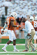 AUSTIN, TX - AUGUST 30:  Texas Longhorns head coach Charlie Strong has words with John Harris #9 against the North Texas Mean Green on August 30, 2014 at Darrell K Royal-Texas Memorial Stadium in Austin, Texas.  (Photo by Cooper Neill/Getty Images) *** Local Caption *** John Harris; Charlie Strong