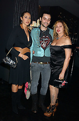 Left to right, MISS TATUM MAZZILLI, MR ROCKY MAZZILLI  and MRS LOUISE MAZZILLI of the Voyage fashion store at a party to celebrate the publication of Tatler's Little Black Book 2005 held at the Baglioni Hotel, 60 Hyde Park Gate, London SW7 on 9th November 2005.<br />