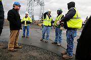 Workers prepare for the delivery of four new transformers at the Robert Moses-Robert H. Saunders Dam in Massena on Wednesday, November 12, 2014.