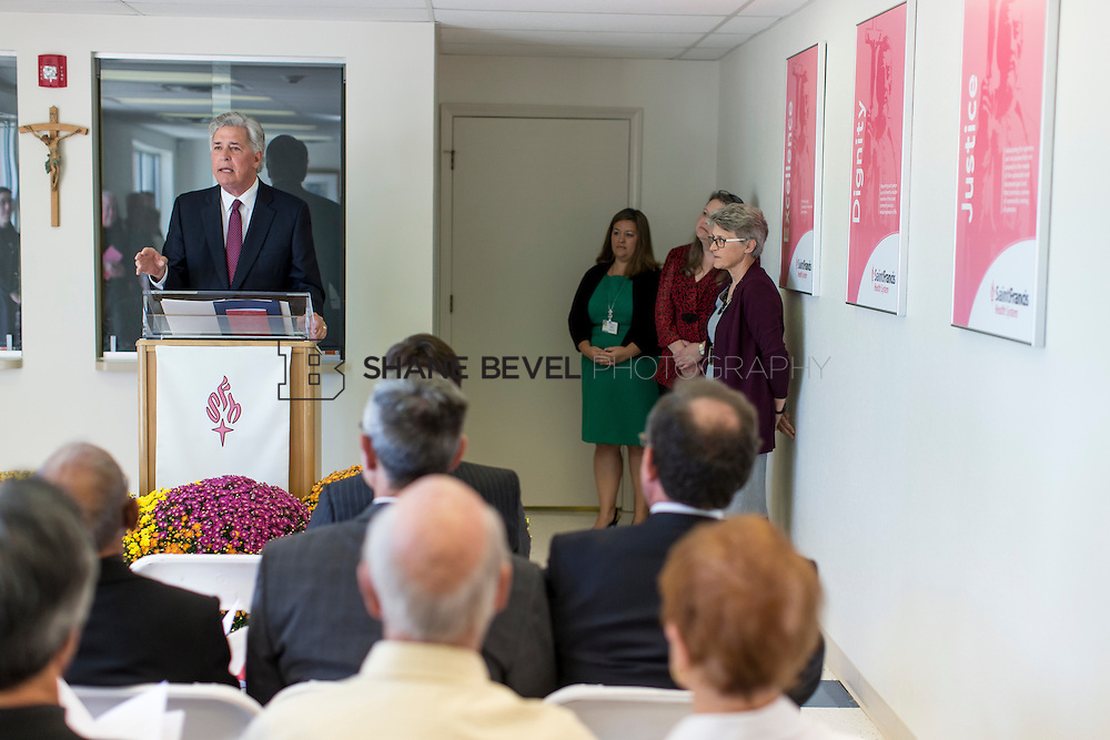 9/29/16 4:04:02 PM --  Bishop David Konderla blesses the newly remodeled Xavier Clinic in east Tulsa. <br /> <br /> Photo by Shane Bevel