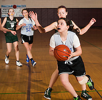 Gilford's Abby O'Connor gets to the basket ahead of TTCC's Madison Williamhan during the Championship round of the senior girls division at the 20th annual Francoeur Babcock Basketball Tournament Sunday morning.  (Karen Bobotas/for the Laconia Daily Sun)