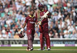 West Indies' Evin Lewis (left) celebrates his century with Jason Holder during the Fourth Royal London One Day International at the Kia Oval, London.