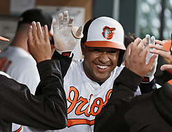August 29, 2017 - Baltimore, MD, USA - The Baltimore Orioles' Jonathan Schoop celebrates in the dugout after his solo home run against the Seattle Mariners in the first inning at Oriole Park at Camden Yards in Baltimore on Tuesday, Aug. 29, 2017. The Orioles won, 4-0. (Credit Image: © Kenneth K. Lam/TNS via ZUMA Wire)