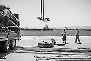 Black & White image of the spreader beam being taken to the vessel