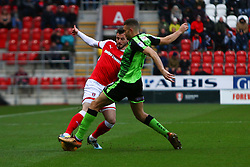 Aaron Taylor-Sinclair of Plymouth Argyle challenges Anthony Forde of Rotherham United for posession  - Mandatory by-line: Ryan Crockett/JMP - 16/12/2017 - FOOTBALL - Aesseal New York Stadium - Rotherham, England - Rotherham United v Plymouth Argyle - Sky Bet League One