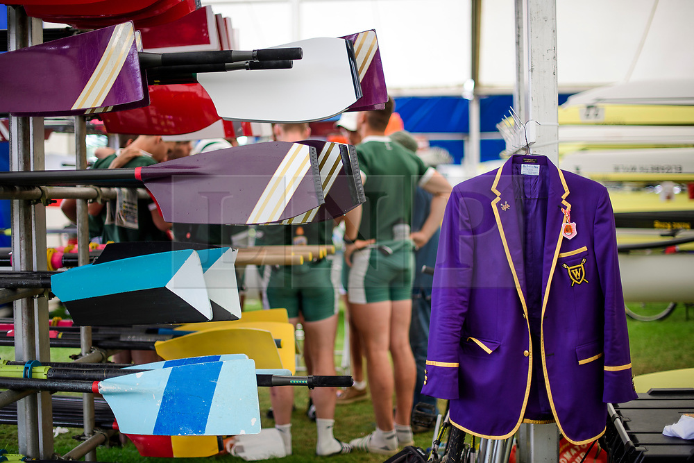 © Licensed to London News Pictures. 28/06/2017. London, UK. A blazer in rowing club colours hangs next to oars at day one of the Henley Royal Regatta, set on the River Thames by the town of Henley-on-Thames in England.  Established in 1839, the five day international rowing event, raced over a course of 2,112 meters (1 mile 550 yards), is considered an important part of the English social season. Photo credit: Ben Cawthra/LNP