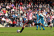 Danny Wright takes his second penalty during the Vanarama National League match between Cheltenham Town and Boreham Wood at Whaddon Road, Cheltenham, England on 25 March 2016. Photo by Carl Hewlett.