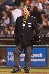 August 8, 2011; San Francisco, CA, USA;  MLB umpire Ed Rapuano (19) stands behind home plate during the fourth inning between the San Francisco Giants and the Pittsburgh Pirates at AT&T Park. Pittsburgh defeated San Francisco 5-0.