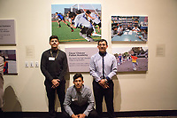 César Chávez Fútbol Academy players in front of their photographs at the December 5th, 2017 opening of the Stories from Salinas exhibition at the CSUMB Salinas Center for Arts and Culture in Oldtown. The exhibition celebrates the mentors, youth and families of the Salinas Youth Initiative.