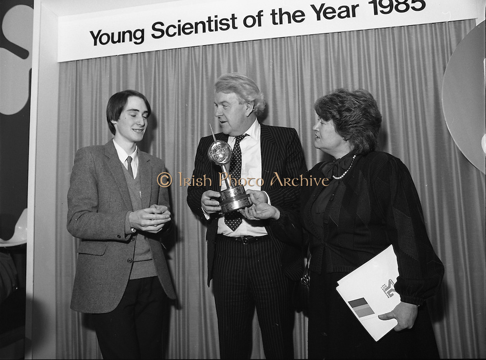 11/01/1985.01/11/1985.11th January 1985.The Aer Lingus Young Scientist Exhibition at the RDS Dublin...Ronan McNulty, (left) of Rathfarhnam, Dublin, the Aer Lingus Young Scientist of the Year 1985, with Norman Scott, the Northern Ireland Minister for Education and Gemma Hussey, T.D, Minister for Education.