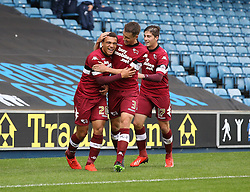 Derby County's Mason Bennett is celebrates with  Graig Forsyth and Kieron Freeman after scoring  - Photo mandatory by-line: Robin White/JMP - Tel: Mobile: 07966 386802 14/09/2013 - SPORT - FOOTBALL -  The Den - London - Millwall V Derby County - Sky Bet League Championship