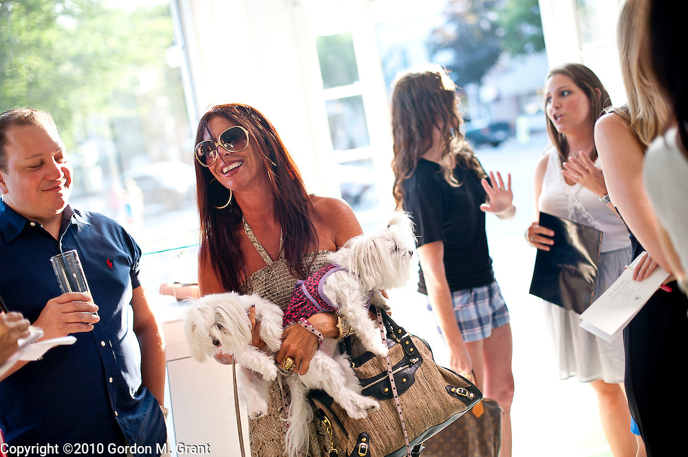 East Hampton, NY - 7/28/10 - Karyn Oksenhorn arrives with her dogs at the Balenciaga store in East Hampton Wednesday, which was holding a private shopping benefit for Baby Buggy, an organization founded by Jessica Seinfeld, in East Hampton, NY July 28, 2010. CREDIT: Gordon M. Grant for The Wall Street Journal.NYBabyBuggy