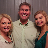 Left to right Shelli Horger, Eddie Horger, and Sutton Horger pose for a photo during the Green Party Sunday September 7, 2014 at City Stage Co. (Jason A. Frizzelle)