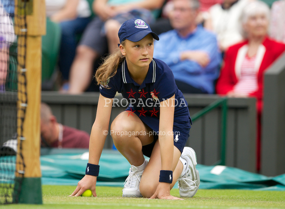 LONDON, ENGLAND - Friday, June 29, 2012: A ball girl during the Gentlemen's Singles 3rd Round match on day five of the Wimbledon Lawn Tennis Championships at the All England Lawn Tennis and Croquet Club. (Pic by David Rawcliffe/Propaganda)