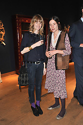 Left to right, CATHERINE FITZGERALD wife of actor Dominic West and EMILY BEARN at a party to celebrate the publication of The irish Country House written by The Knight of Glin and James Peill with photographs by James Fennell, held at Christie's, King Street, London on 24th January 2011.