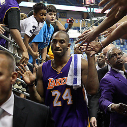 April 28, 2011; New Orleans, LA, USA; Los Angeles Lakers shooting guard Kobe Bryant (24) celebrates following a win over the New Orleans Hornets in game six of the first round of the 2011 NBA playoffs at the New Orleans Arena. The Lakers defeated the Hornets 98-80 to advance to the second round of the playoffs.   Mandatory Credit: Derick E. Hingle