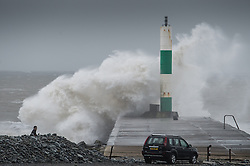 "© London News Pictures. 08/02/2014. Aberystwyth, UK. <br /> Gale force winds and big waves begin to strike the sea walls at Aberystwyth on the west wales coast.  The winds are forecast to strengthen throughout the day, gusting up to 70 or 80 mph, and with the rising tide, their impact could be potentially damaging again. An amber ""be prepared"" warning  has been issued by the Met Office for wind,. Photo credit: Keith Morris/LNP"