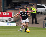 5th May 2018, Dens Park, Dundee, Scotland; Scottish Premier League football, Dundee versus Hamilton Academical; Cammy Kerr of Dundee bursts away from Daniel Redmond of Hamilton Academical