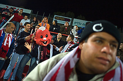 Arab fans cheer for the Bnei Sahknin team at Bloomfield Stadium, Jaffa, Israel, Jan. 29, 2006.The team has a mixture of Israeli-Arab, Israeli, and foreign players. Suan, an Israeli-Arab, still faces criticism and racism resulting from the unsettled conflict between the Israelis and Palestinians.