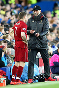 Liverpool Manager Jurgen Klopp tells substitute Liverpool midfielder James Milner (7) what he wants him to do when he goes on  during the Premier League match between Everton and Liverpool at Goodison Park, Liverpool, England on 3 March 2019.