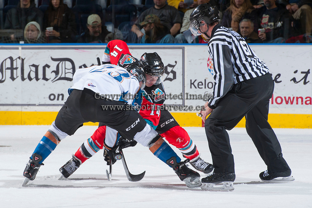 KELOWNA, CANADA - DECEMBER 7: Rourke Chartier #14 of the Kelowna Rockets faces off against Sam Reinhart #23 of the Kootenay Ice on December 7, 2013 at Prospera Place in Kelowna, British Columbia, Canada.   (Photo by Marissa Baecker/Shoot the Breeze)  ***  Local Caption  ***
