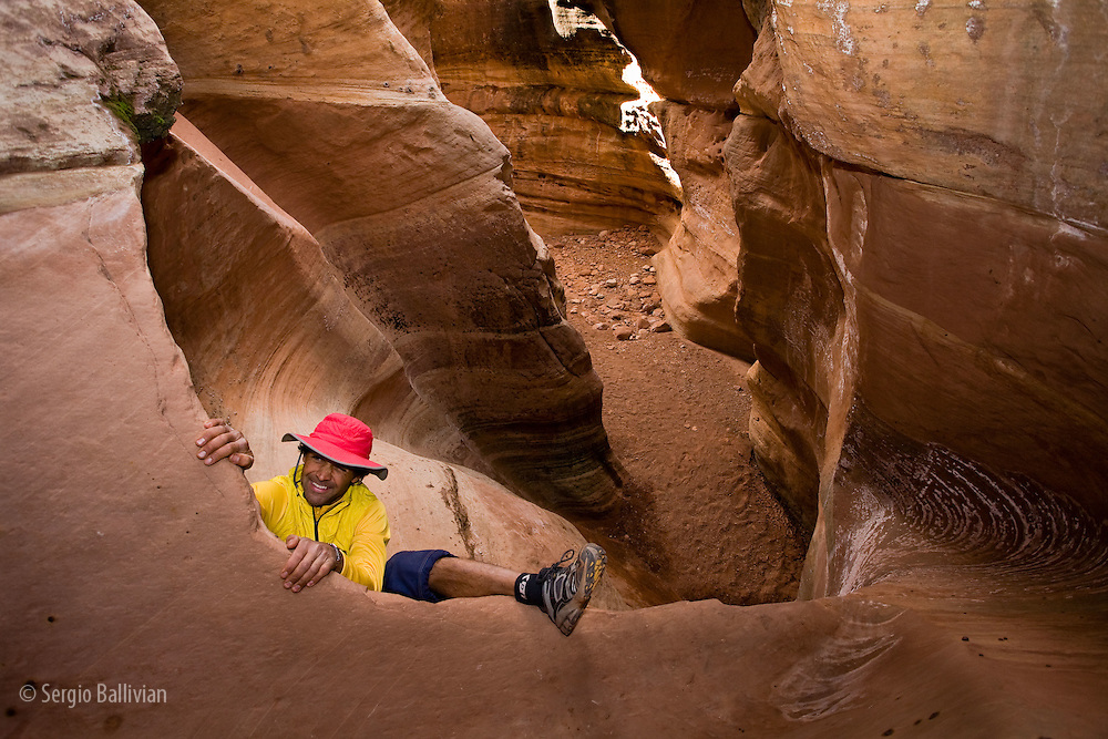 Jeet Grewal in a slot canyon as seen from the White Rim Trail in Canyonlands National Park, Utah.