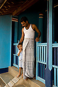 Father & Son at entrance to their home. Thittacheri.