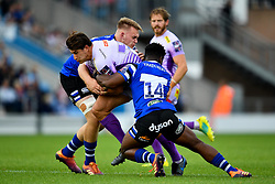 Nahum Merigan of Bath Rugby and Levi Davis of Bath Rugby tackles Tom Hendrickson of Exeter Chiefs - Mandatory by-line: Ryan Hiscott/JMP - 21/09/2019 - RUGBY - Sandy Park - Exeter, England - Exeter Chiefs v Bath Rugby - Premiership Rugby Cup