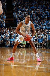 CHAPEL HILL, NC - FEBRUARY 05: Garrison Brooks #15 of the North Carolina Tar Heels plays during a game against the North Carolina State Wolfpack on February 05, 2019 at the Dean Smith Center in Chapel Hill, North Carolina. North Carolina won 113-96. North Carolina wore retro uniforms to honor the 50th anniversary of the 1967-69 team. (Photo by Peyton Williams/UNC/Getty Images) *** Local Caption *** Garrison Brooks