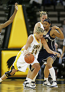 28 NOVEMBER 2007: Iowa forward Johanna Solverson (34) tries to get around Georgia Tech guard Jill Ingram (5) in the second half of Georgia Tech's 76-57 win over Iowa in the Big Ten/ACC Challenge at Carver-Hawkeye Arena in Iowa City, Iowa on November 28, 2007.