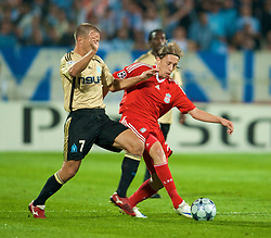 MARSEILLE, FRANCE - Tuesday, September 16, 2008: Liverpool's Lucas Leiva and Olympique de Marseille's Benoit Cheyrou during the opening UEFA Champions League Group D match at the Stade Velodrome. (Photo by David Rawcliffe/Propaganda)