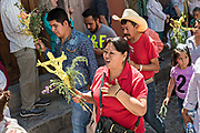 Christian believers follow a procession through the city center during Palm Sunday marking the start of Holy Week March 25, 2018 in San Miguel de Allende, Mexico. Christians commemorate the entry of Jesus into Jerusalem when it was believed that the citizens laid down palm branches in his path.