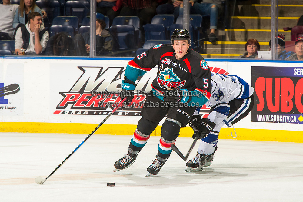 KELOWNA, CANADA - NOVEMBER 23: Cayde Augustine #5 of the Kelowna Rockets is back checked by Kaid Oliver #34 of the Victoria Royals on November 23, 2018 at Prospera Place in Kelowna, British Columbia, Canada.  (Photo by Marissa Baecker/Shoot the Breeze)