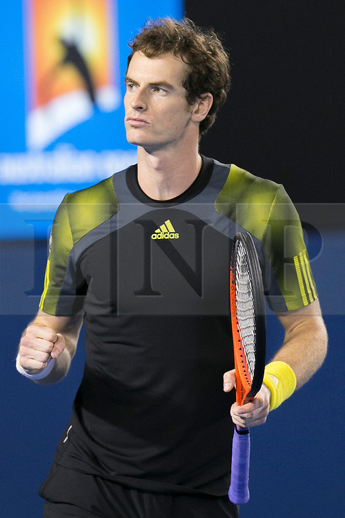 © Licensed to London News Pictures. 25/01/2013. Melbourne Park, Australia.  A victorious Andy Murray clenches his fist in celebration after winning during the Mens Semi Final between Andy Murray Vs Roger Federer of the Australian Open. Photo credit : Asanka Brendon Ratnayake/LNP